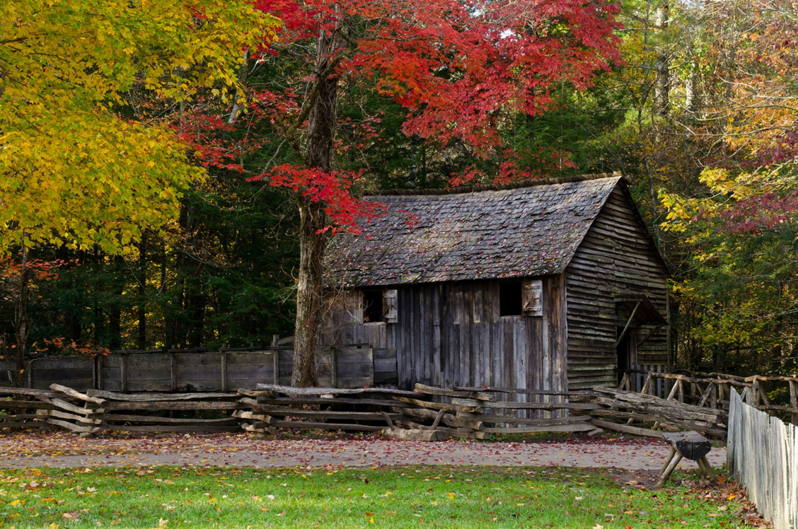 Us department of the interior an old wooden cabin surrounded by a wooden fence stands on the edge of a forest publicscrutiny Image collections