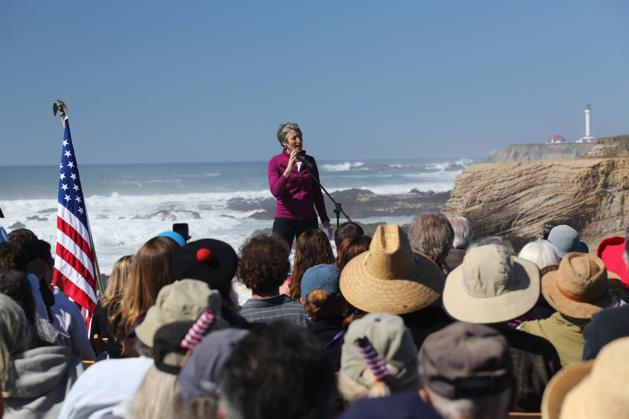 Secretary Jewell speaking on an ocean shore