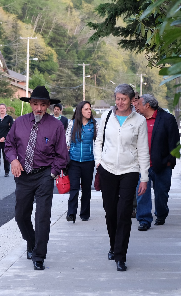 Secretary Jewell (right) walks with Thomas P. O'Rourke (left), Chairman of the Yurok Tribe