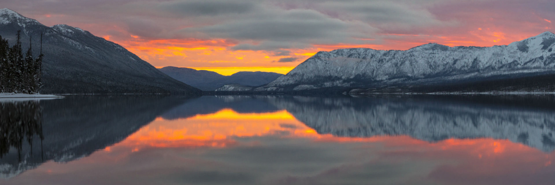 Sunset over Apgar Mountains with lake