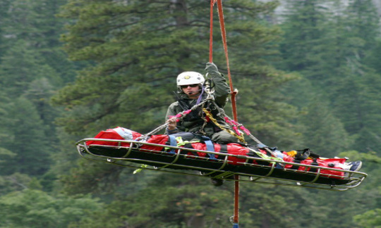 Leslie Reynolds helicopters through the forests atop of a visitor she rescued.