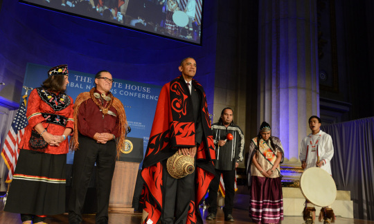 President Obama on stage with tribal leaders.