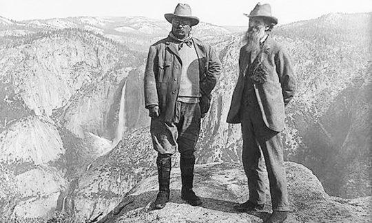 Theodore Roosevelt and John Muir stand in Yosemite National Park