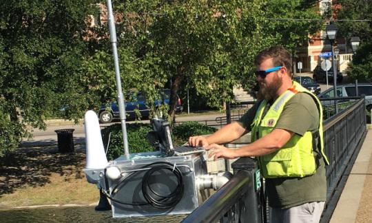 A USGS hydrologic technician installs a Rapid-Deployment Gauge.