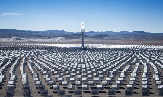 Thousands of mirrors reflect sunlight on to a tower at a solar energy facility in the Nevada desert.
