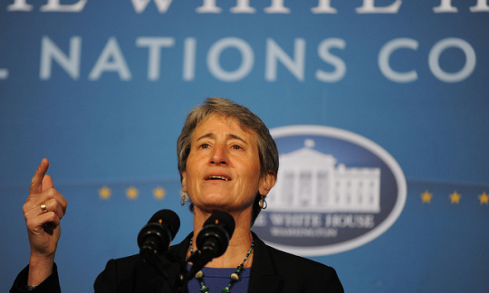 Secretary Jewell addresses a crowd from behind a podium.