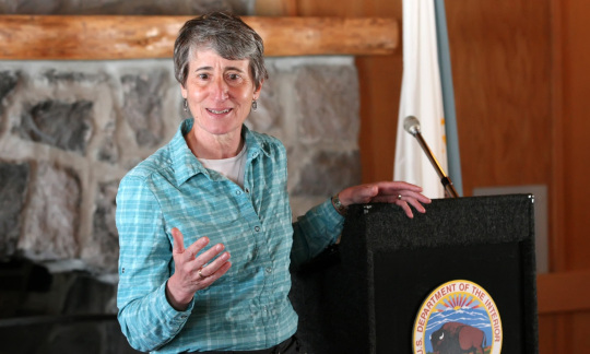 Secretary Jewell speaks in front of a podium