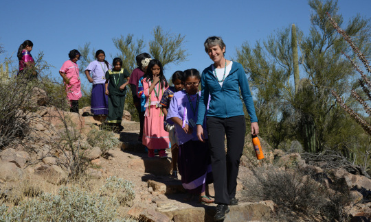 Secretary Jewell hiking with a group of kids.