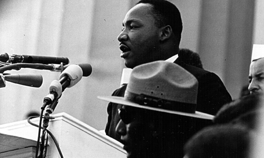 Dr. Martin Luther King Jr. speaking on the steps of the Lincoln Memorial during the March on Washington in August, 1963.
