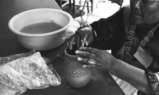 Marie Chino of Acoma Pueblo coiling a new vase, 1967. © IACB