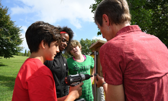 Secretary Jewell builds a birdhouse with three middle school students