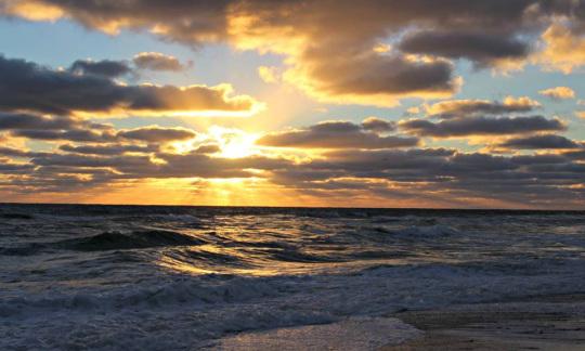 Sun rising over the Atlantic Ocean at Cape Cod National Seashore