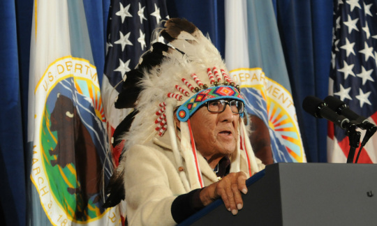 Photo of Dr. Joseph Medicine Crow in a traditional headdress.