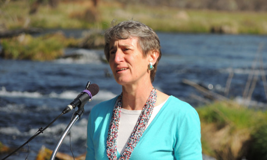 Secretary of the Interior Sally Jewell standing in front of a Klamath River tributary