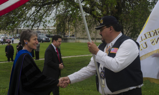 Secretary Jewell shakes hands with a Native American man.