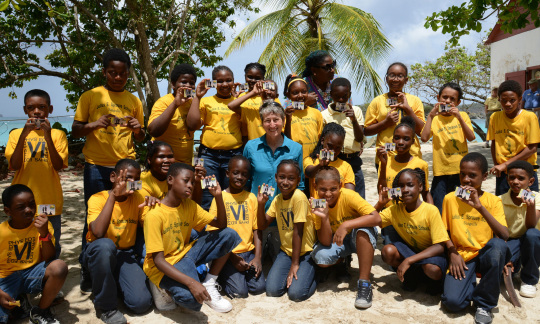 Secretary Jewell poses with kids on the beach.