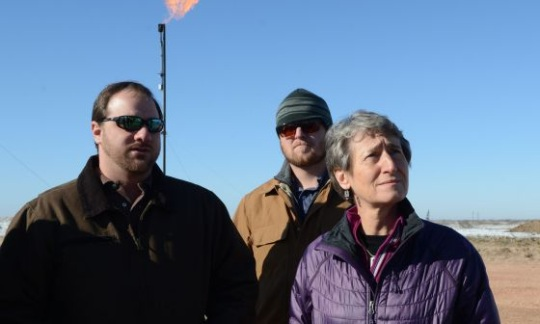 Secretary Jewell stands with two men during a site visit to see venting and flaring operations