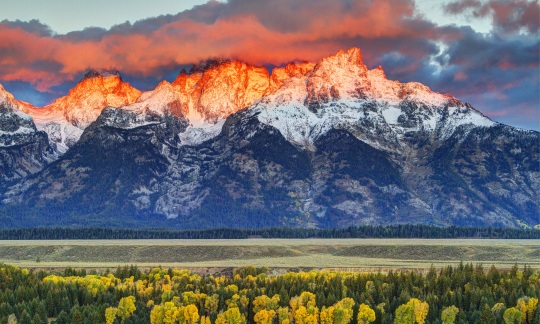 The setting sun shines pink and orange on the mountains of Grand Teton National Park. Photo by Robert Buman (www.sharetheexperience.org).