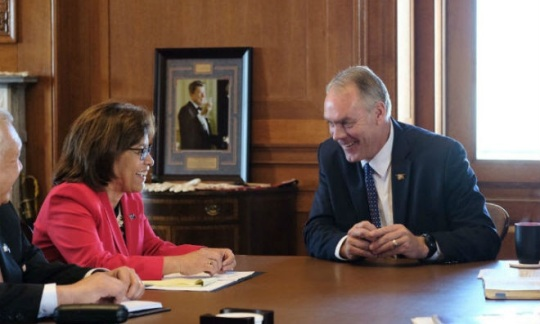 Marshall Islands President Hilda Heine and Secretary Zinke at a table in his office.