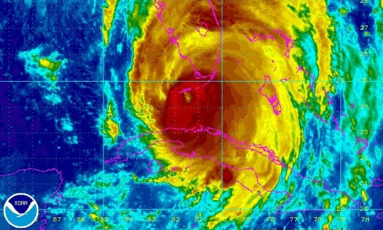 Colorful satellite photo of Hurricane Irma over Florida.