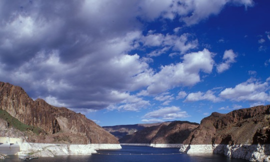 A cloudy blue sky overlooks a lake in Nevada.