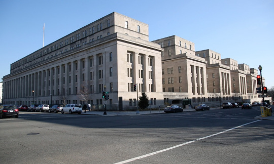 The Department of the Interior main Building casts a shadow from the viewpoint of the opposite corner.