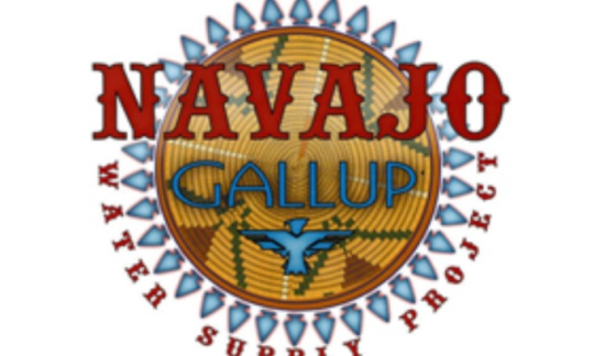 A circular logo with native american designs and text that says Navajo Gallup.