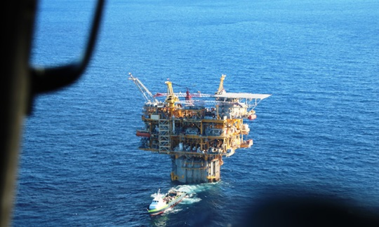 Offshore rig as seen from the window of an inspection helicopter.