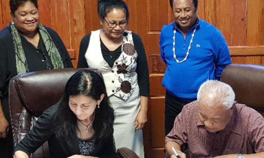 U.S. Ambassador Amy Hyatt and Republic of Palau's Minister of Finance Elbuchel Sadang sign the Palau Compact Funding Agreement
