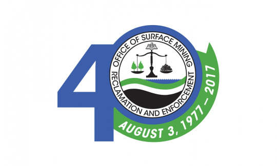 The circular seal of the Office of Surface Mining includes a set of scales balancing lumps of coal and trees.