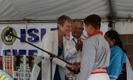 Secretary Jewell shakes hands with a Native American at the Pueblo of Isleta