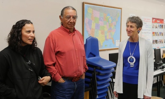 Secretary Jewell standing in a classroom with two officials from the Standing Rock Sioux.
