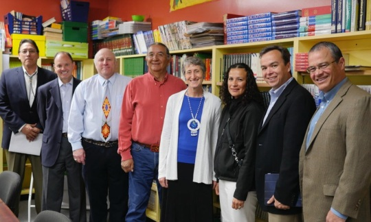 A line of people including Secretary Jewell and officials from Interior and the Standing Rock Sioux in a classroom.
