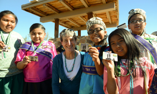 Secretary Jewell poses with a group of young people holding up their new park passes.