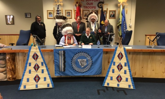 Secretary Zinke sits at a table with members of the Blackfoot Tribe.