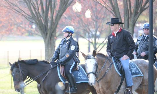 Secretary Zinke on horseback with members of law enforcement in a DC park.