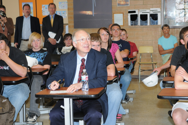 Secretary Ken Salazar listens to students talk about wind energy efforts at Milford High School.