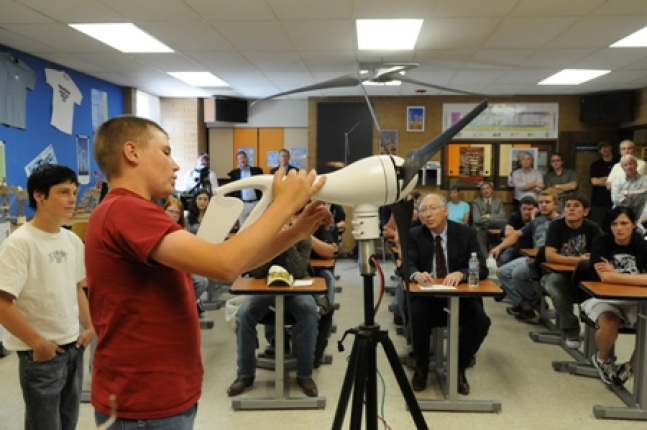 Students at Milford High School in Utah show Secretary Salazar their wind energy research.
