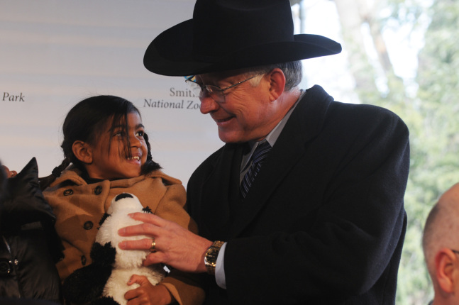 Secretary Salazar and young child.