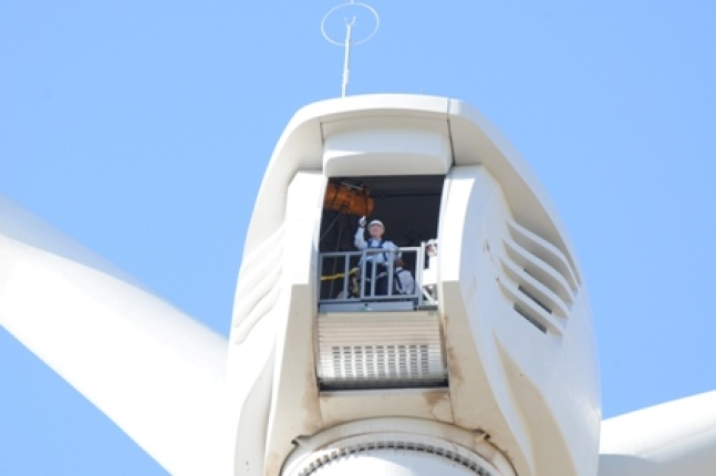 Secretary Ken Salazar stands at the top of a wind tower in the Milford Wind Corridor.