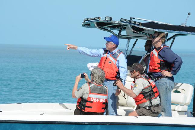 Secretary Salazar, Assistant Secretary Shafroth and Fish and Wildlife Service representatives observe a sandbar.