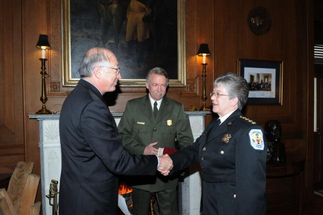 Secretary Salazar congratulates Teresa Chambers on her return to duty.