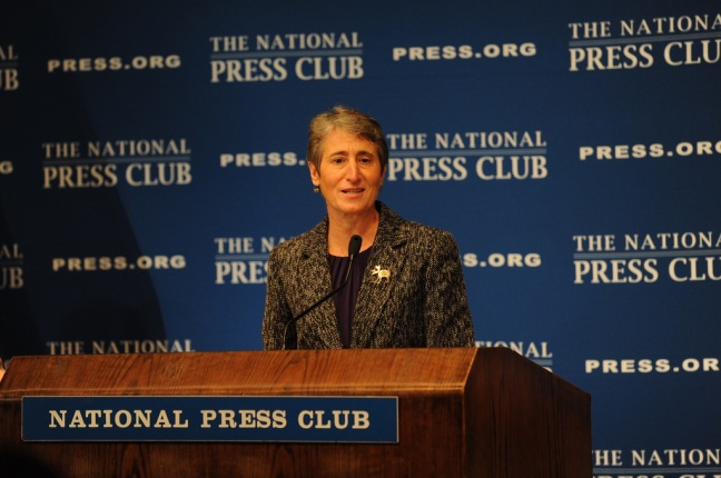 Secretary Jewell speaking behind the National Press Club podium