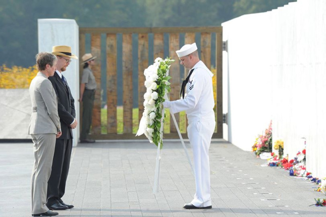 Jewell standing in front of the Flight 93 Memorial with a white wreath