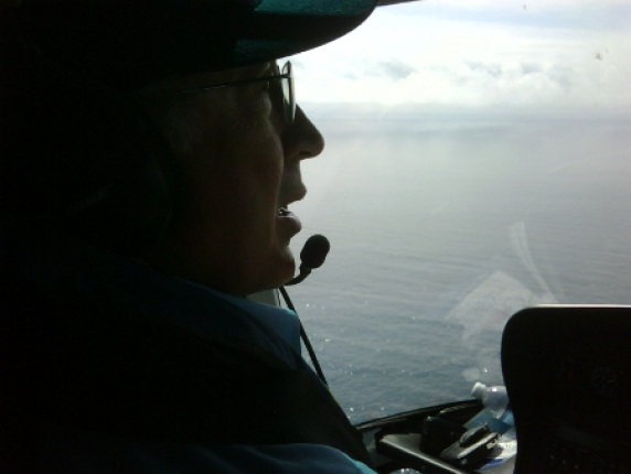 Secretary Salazar surveys oil on the surface water of the Gulf from the Deepwater Horizon oil spill.