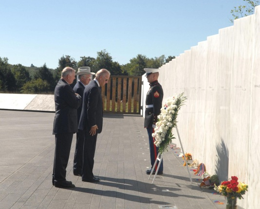 Vice President Joe Biden and Secretary Salazar stand before a wreath laying at the Wall of Names during the annual September 11th observance.
