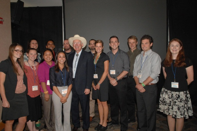 Secretary Salazar poses for a photo with University of Colorado students.