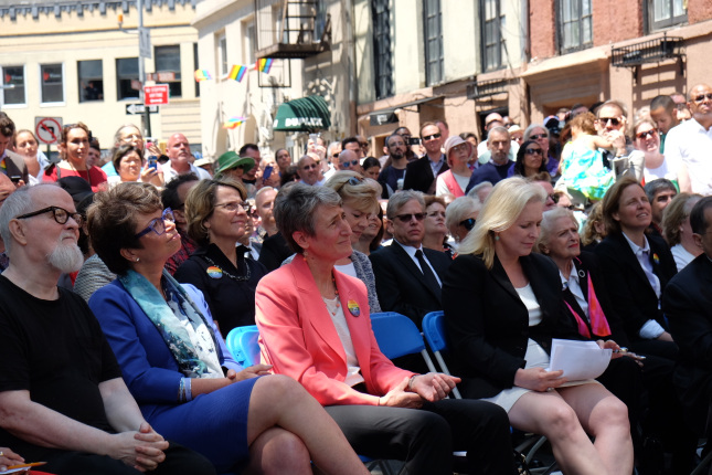 Secretary Jewell attentively listens while sitting with members from the LGBT community.