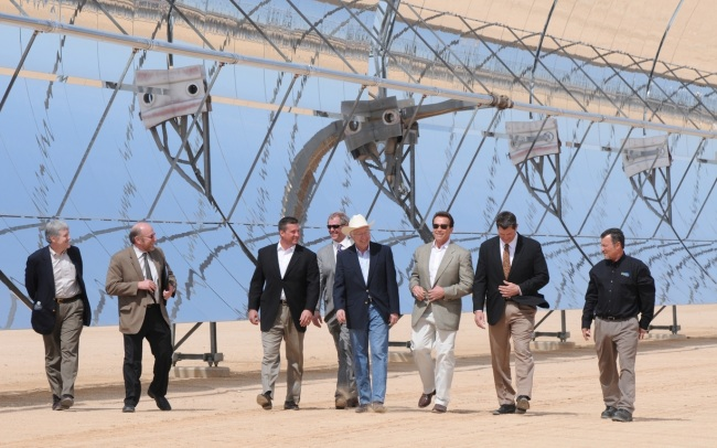 Secretary of the Interior Ken Salazar, California Governor Arnold Schwarzenegger, President and CEO of NextEra Energy Mitch Davidson, Counselor to the Secretary Steve Black and others tour the NextEra Harper Lake solar electric generating system.