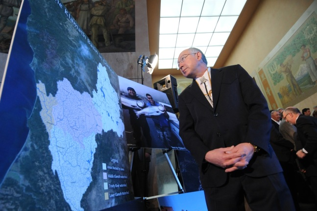 Secretary Salazar looking at a map.
